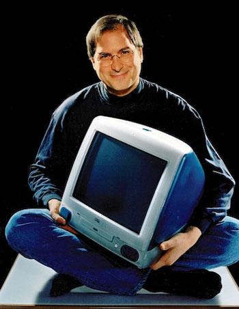 Steve Jobs holding an iMac