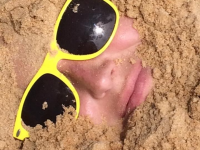 Buried in sand on the beach