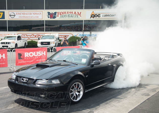 1999-2004 SN95 Convertible Mustang Doing a Burn Out with the Top Down