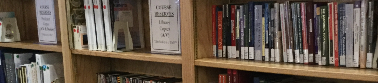 Photo of books on course reserves shelf