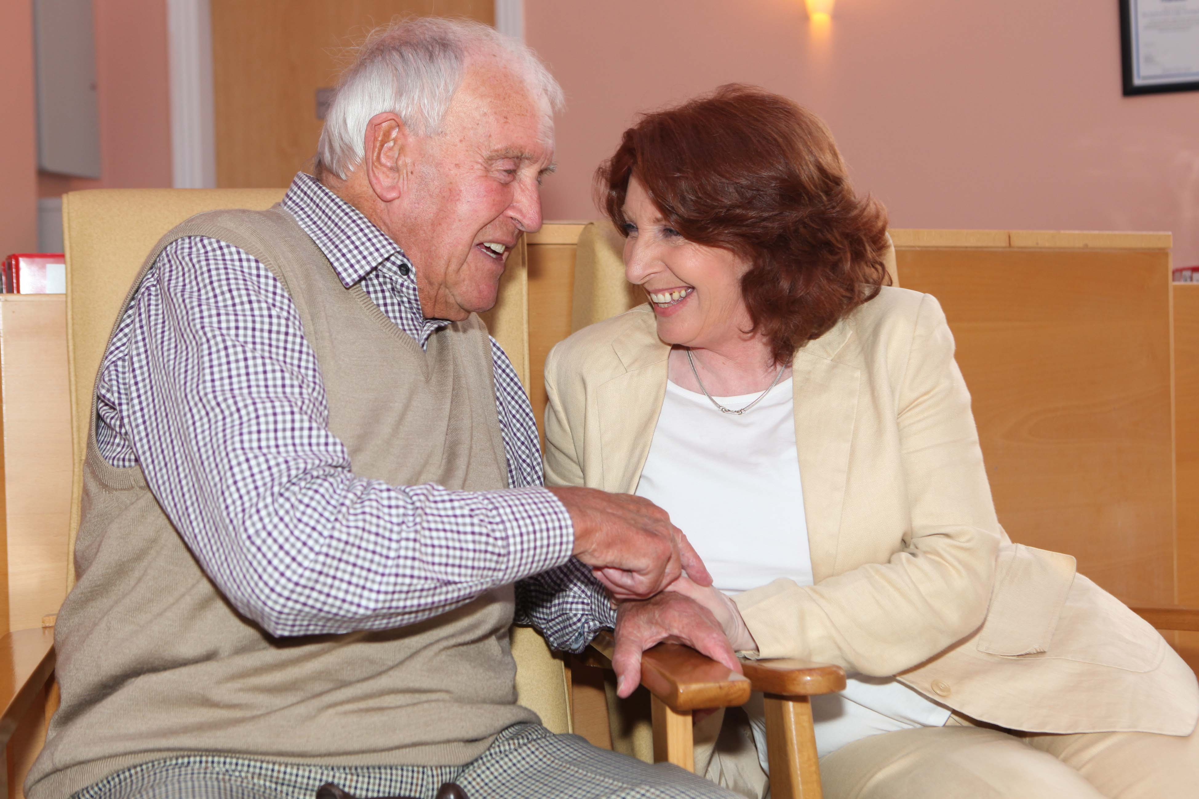 Woman and older man chatting at Oaklodge Nursing H