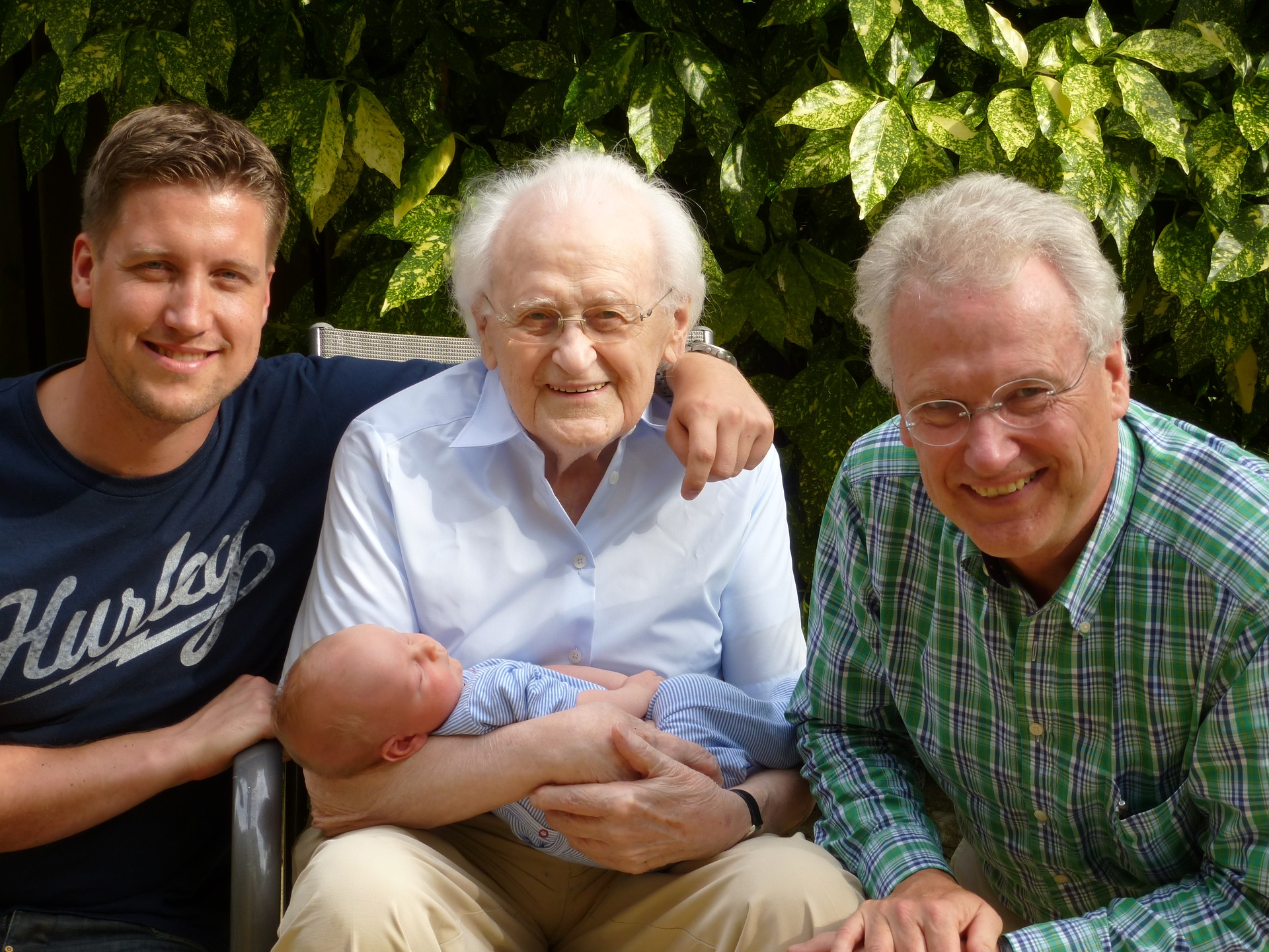 Photo of four generations of men, oldest man holding baby