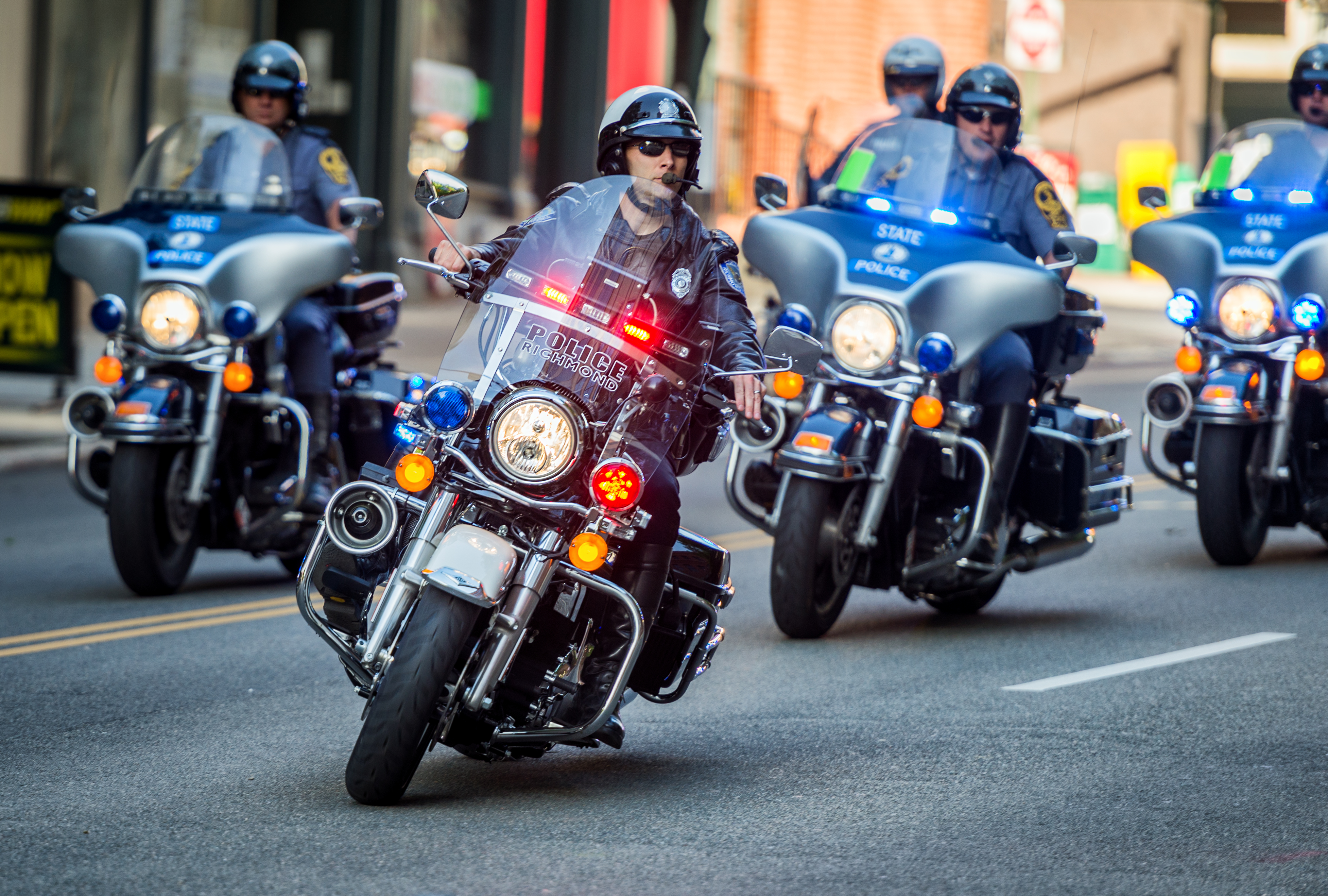 Police officers on motorcycles with flashing lights