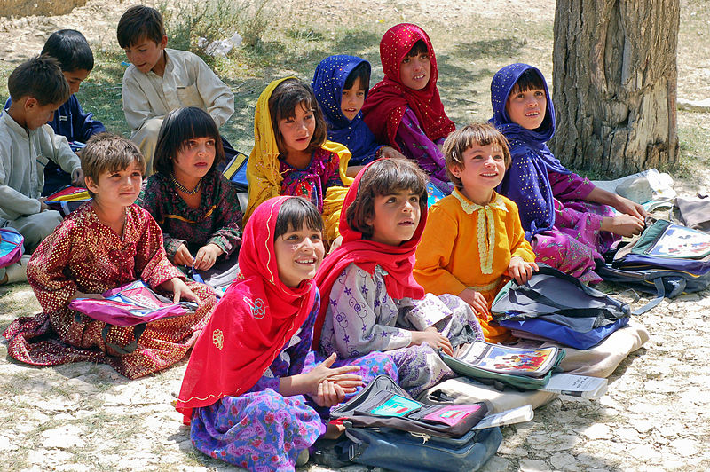 A group of school children in Bamozai, near Gardez, Paktya Province, Afghanistan sit engaged in listening.
