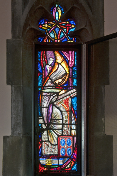 Stained Glass window of monastic scribe as seen in Bapst Library Oratory