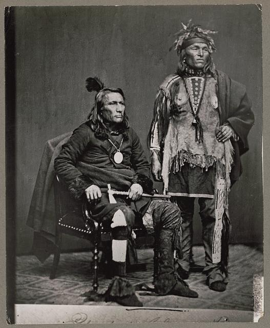 Chief Crane, Potawatomi, holding tomahawk and unidentified Native American man in delegation to Washington, D.C.
