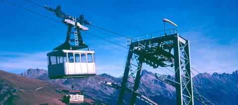 Gondola with mountains in background
