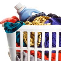 laundry basket of clothes with washing liquid bottle