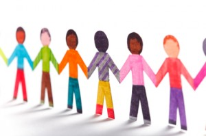 multicolored paper dolls holding hands image
