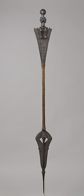 Ceremonial Staff with Seated Female Finial (Kibango). Comes to a sharp point at the bottom.