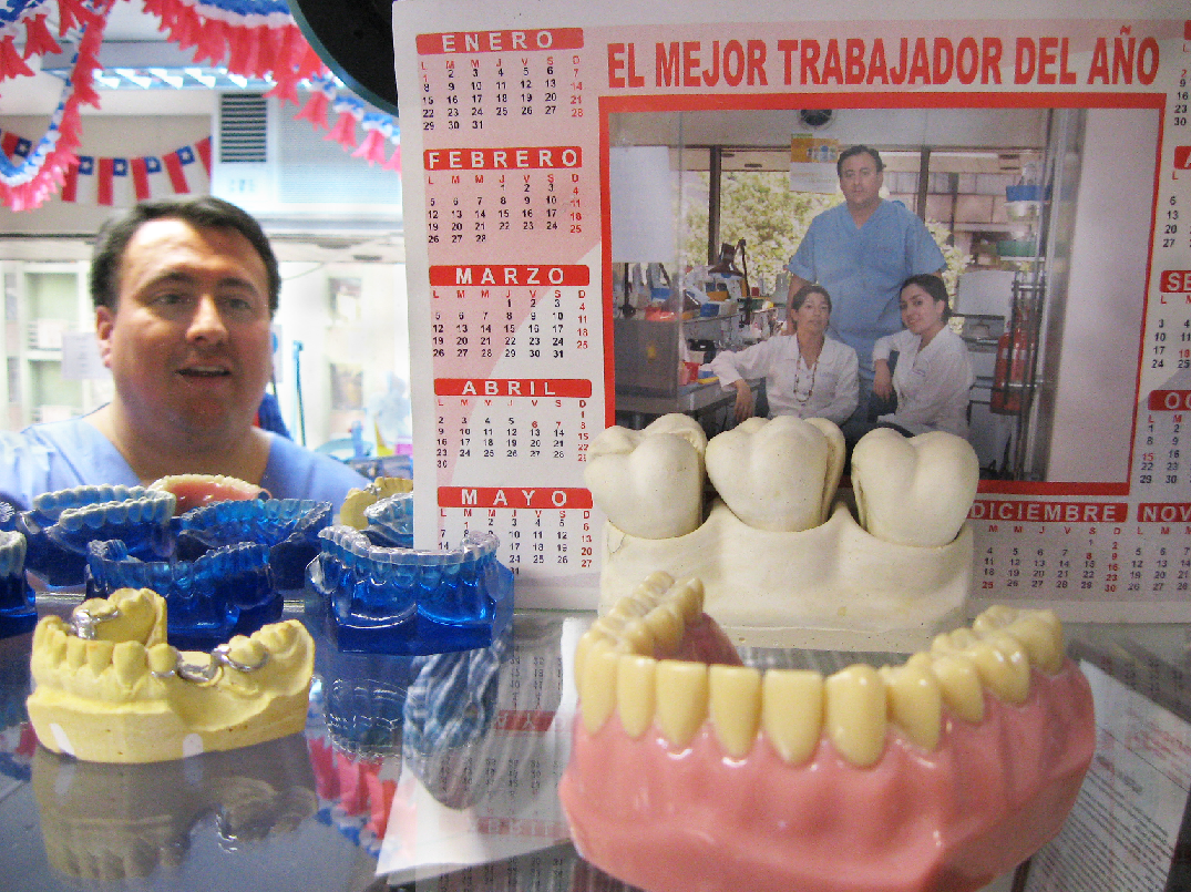 Image of manager looking at products in a private dental laboratory