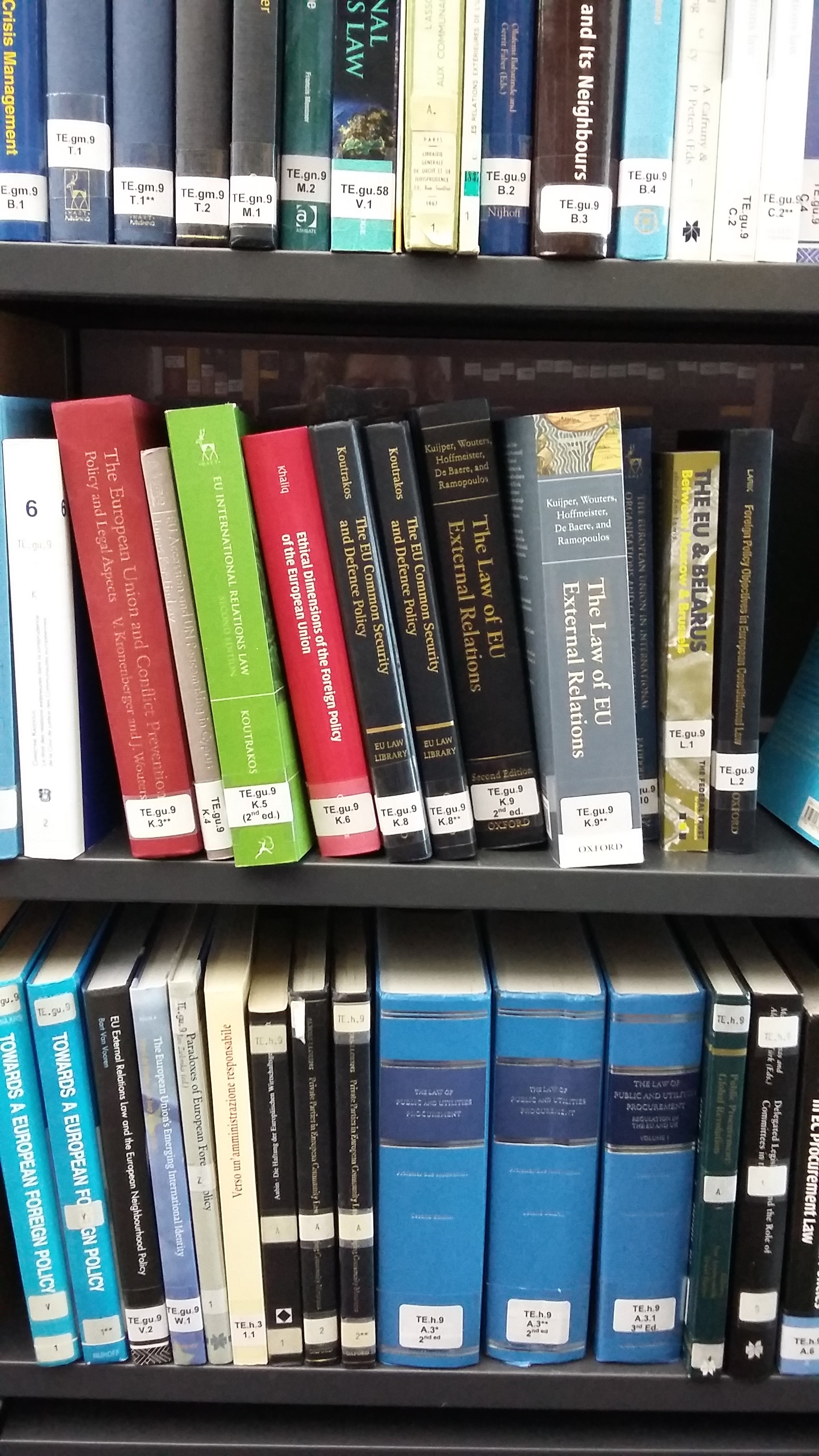 Photo of colourful books on shelves in the EU law section of the Squire Law Library.