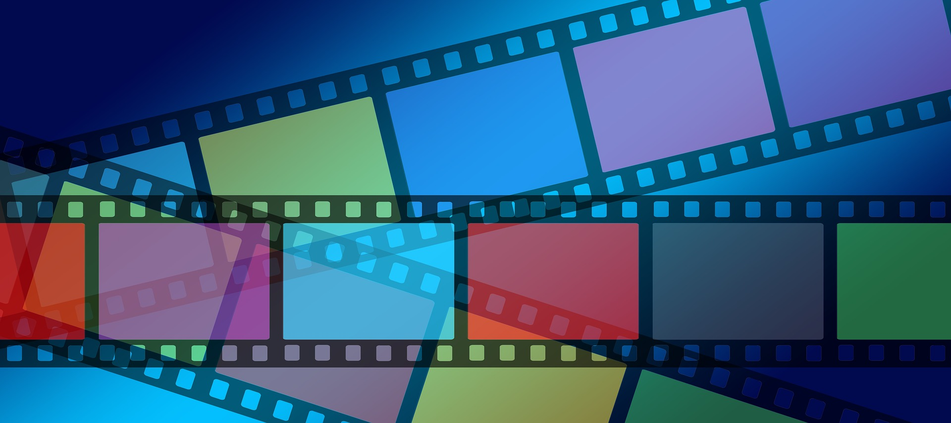 three filmstrips with different colors in each frame, laying on top of each other.