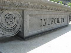 Integrity word carved in stone