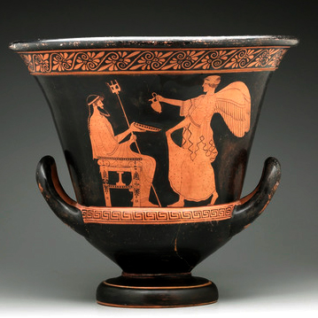 A black Grecian urn with golden engraved figures on it