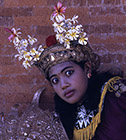 An Indonesian woman wearing a traditional headdress and costume