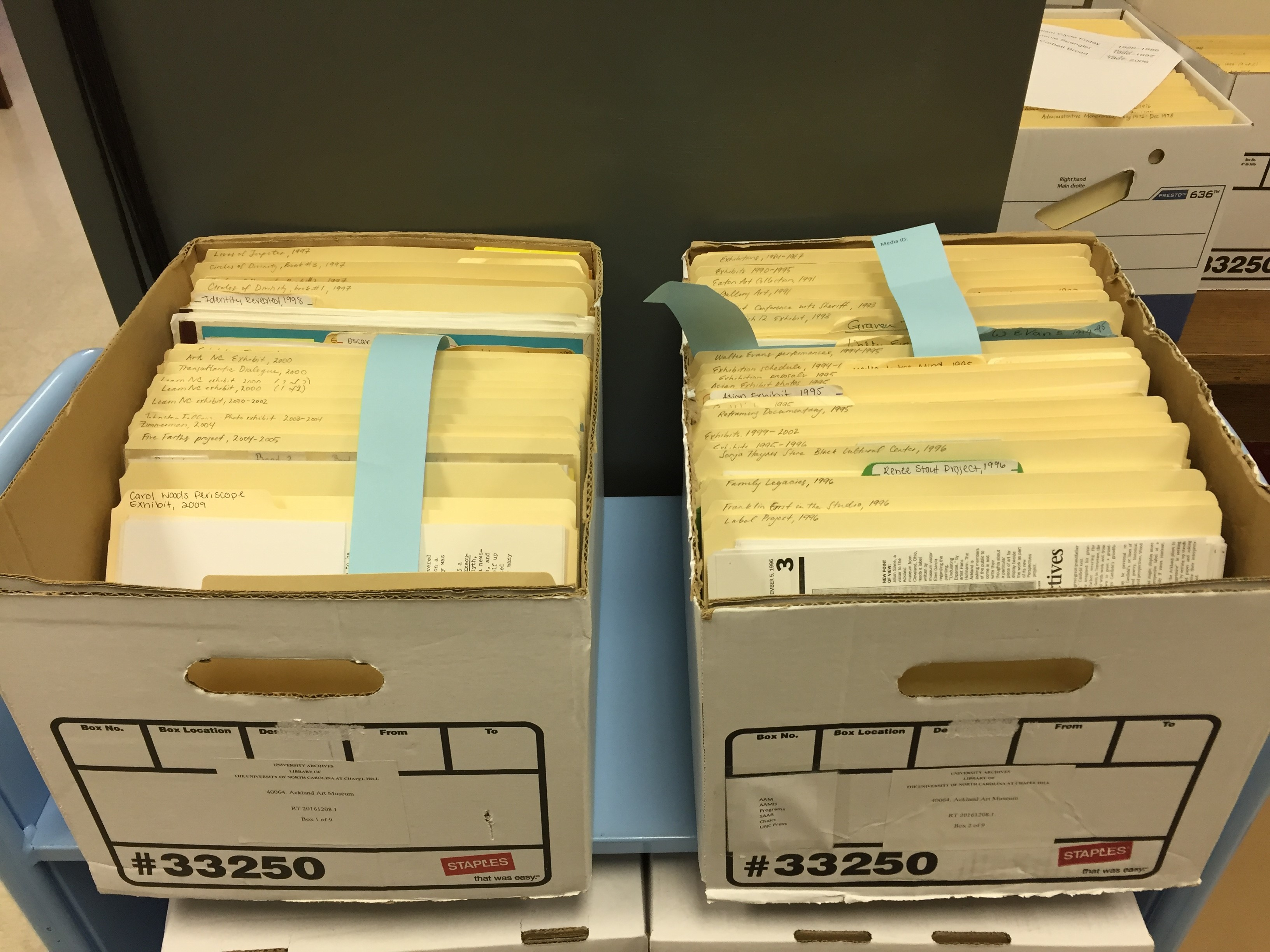 Two archival boxes containing file folders of records.