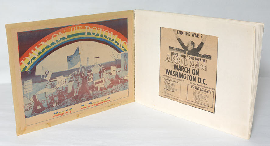 Interior spread from Mayday Scrapbook showing Vietnam War protest posters