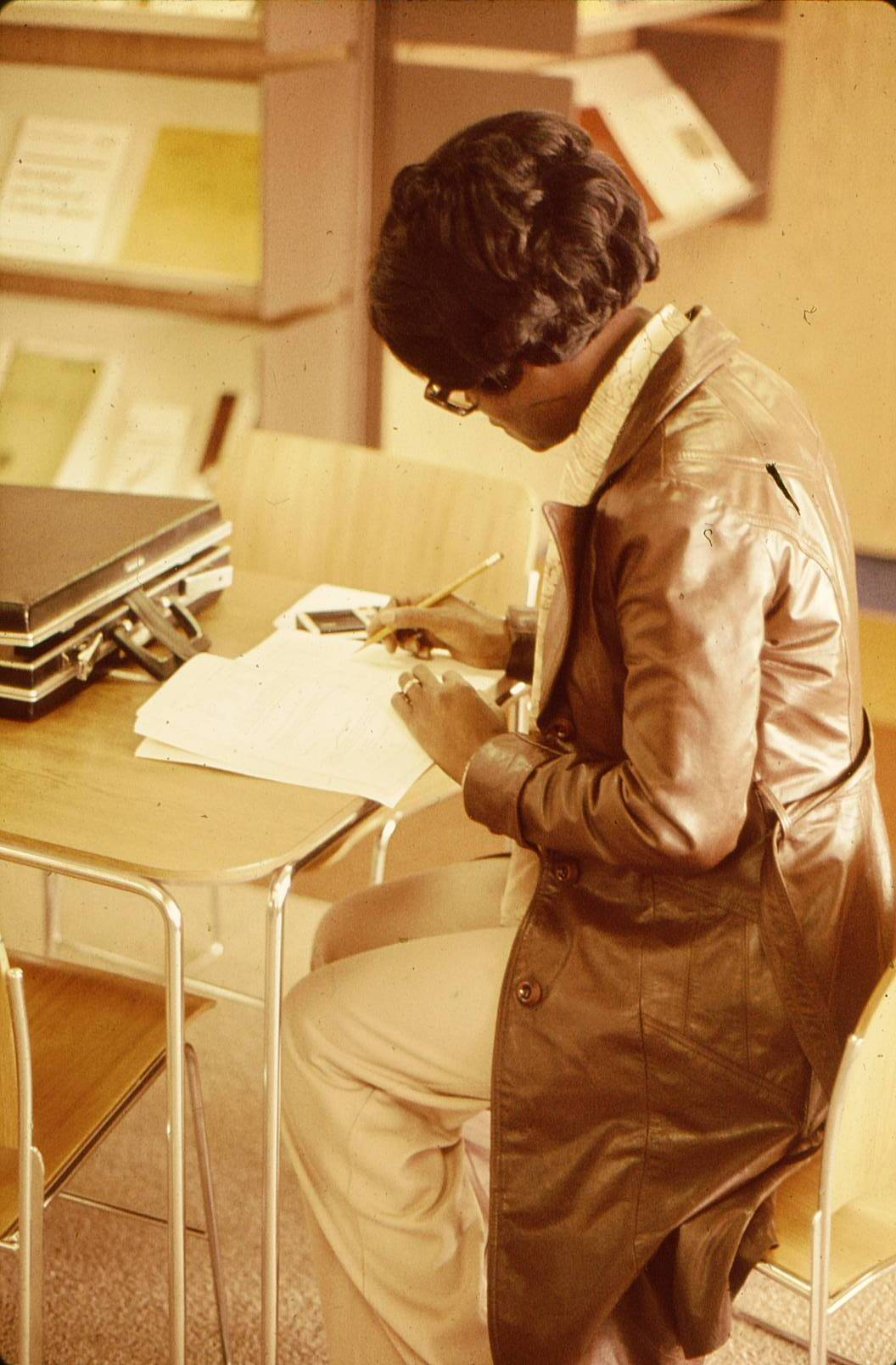 1977 Photo of a student in math lab