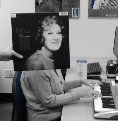 From the Sleeveface Friday gallery on the UNC Music Library's Facebook page, sleeveface photo of student using midi keyboard in music library, incorporating vinyl sleeve of Marian McPartland at the Hickory House