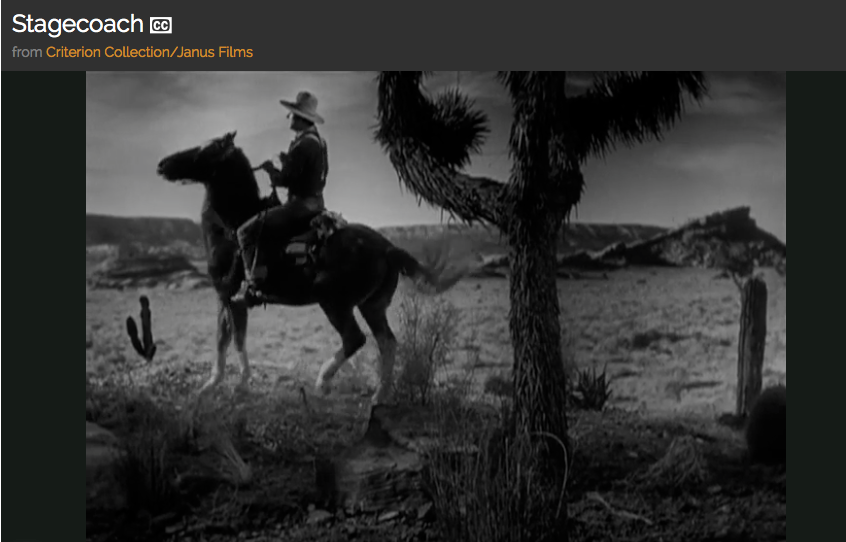 A man on a horse in a desert