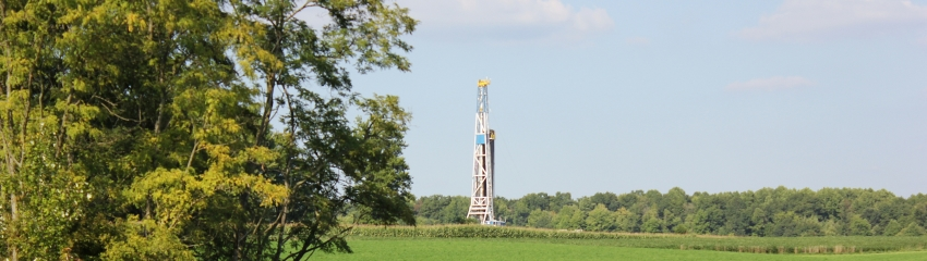 a natural gas well  head in a a green field