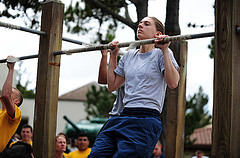 person doing chin-ups