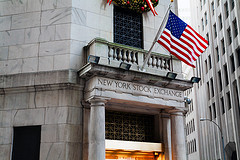 Entrance to New York Stock Exchange with U.S. flag
