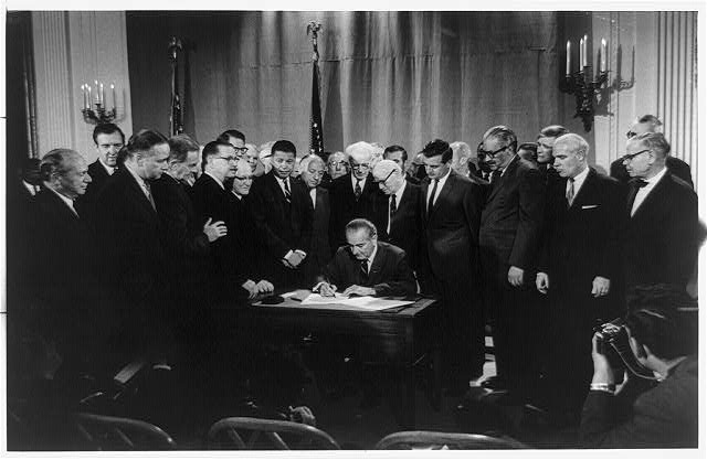 Lyndon Baines Johnson signing Civil Rights Bill