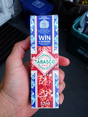 hand holding a Tabasco sauce package