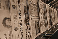 newspapers on a display rack
