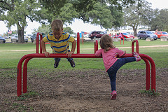 two children playing at a playground