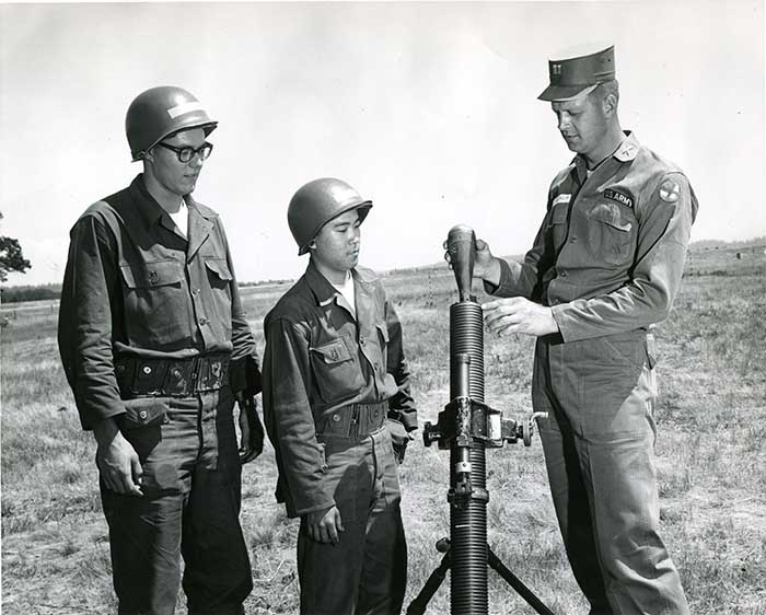 Capt. William R. Gillingham Explains the Use of the Mortar to GU Cadets George J. Kurka (left) and Richard K. Yorioka at ROTC Summer Camp, Fr. Lewis, WA, 1961-1962