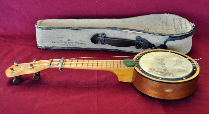 Banjolele: Tenor Banjolele and Canvas Case Owned by Lyle W. Moore. New York: Mele B&J. 1920s.