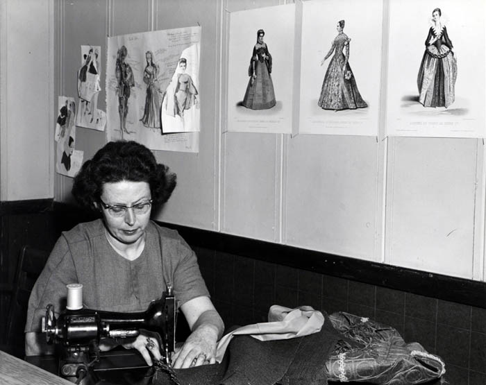 "Mrs. Robert J. Albi sewing costumes for ""Kiss Me Kate,"" in 1964."