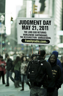 "Man carrying a sign that says ""Judgement Day May 21, 2011"""