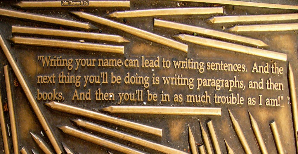 Quote from Henry David Thoreau in bronze plaque: Writing your name can lead to writing sentences. And the next things you'll be doing is writing paragraphs, and then books. And then you'll be in as much trouble as I am.