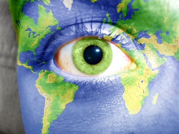 Image of a human eye with globe of the earth painted on the face around it
