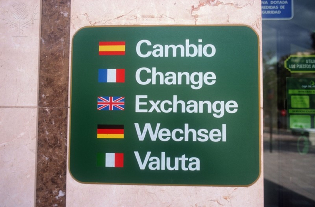 Multilingual sign reading Change in English, German, Spanish, French and Italian - Britannica ImageQuest