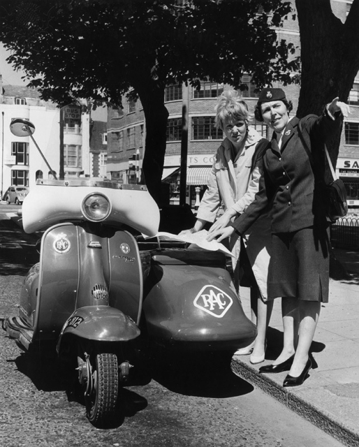 Royal Automobile Club patrol woman giving directions, 1962 - Britannica ImageQuest
