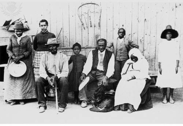 Harriet Tubman, (c1823-1913), American abolitionist, photographed with former slaves late in her life, Britannica ImageQuest