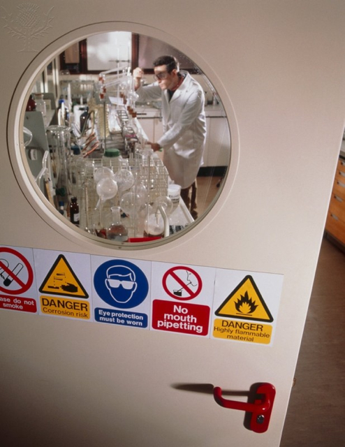 Britannica ImageQuest - Safety signs seen on a laboratory door