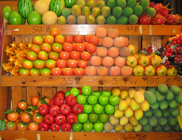 Fruits and vegetables arranged on shelves
