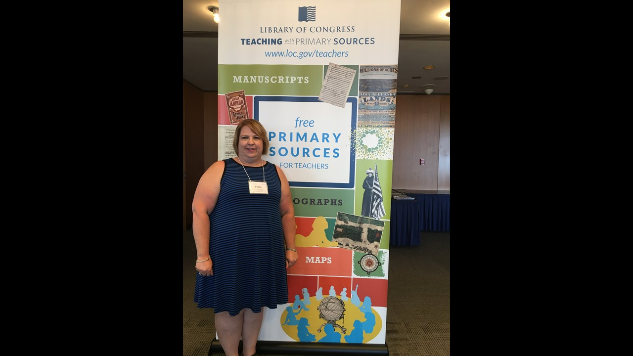 Ms. Coomer at Library of Congress Summer Teacher Institute banner.