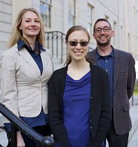 three librarians on the steps of a white building