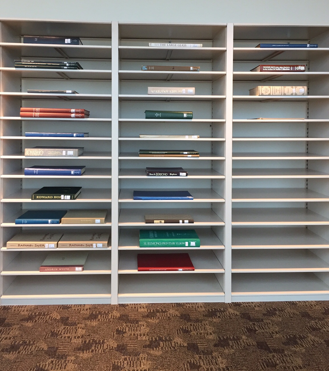 Oversize folio books stacked on a specific oversize folio shelf on the library's second floor.
