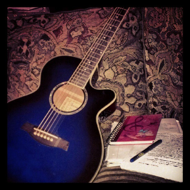 Guitar and notebooks
