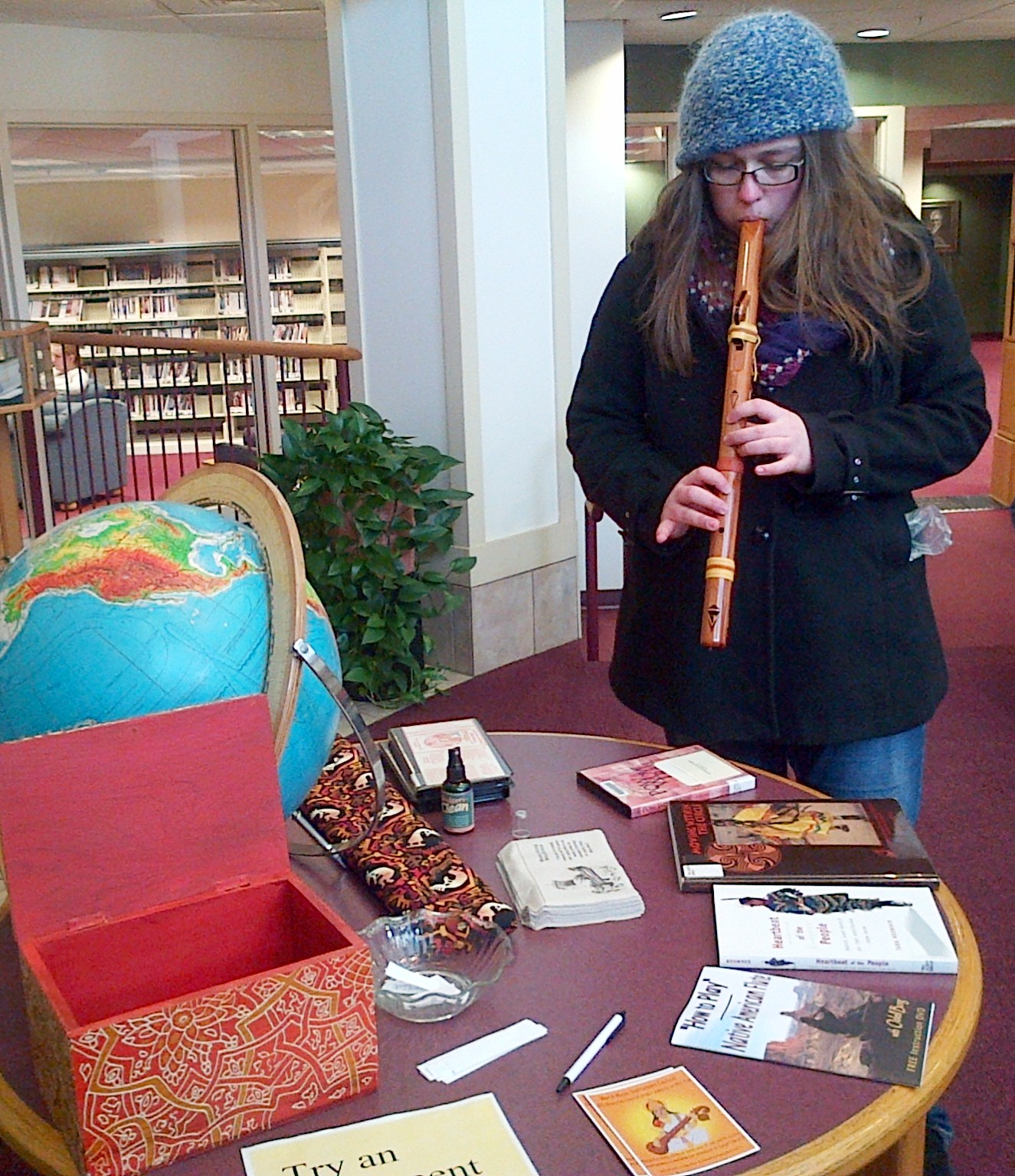 Wartburg student tries the native flute