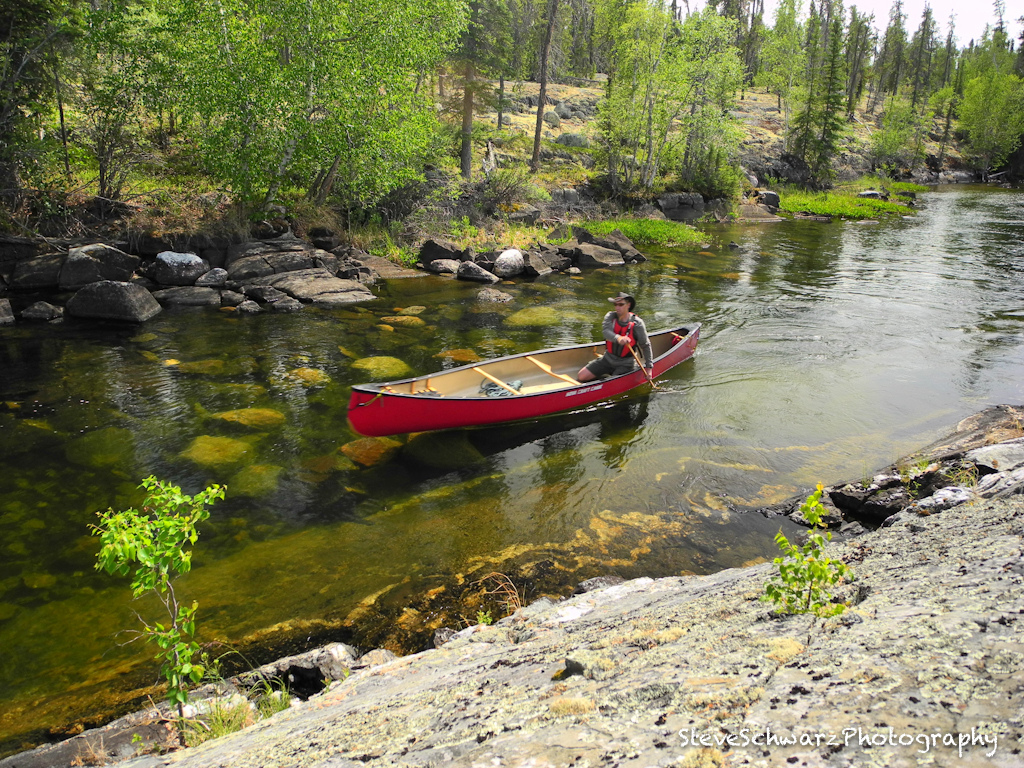 Man canoeing in river