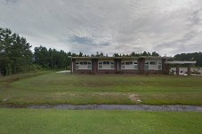 Image of the Dorchester County Quickjobs Training Center. red brick building in field of green grass